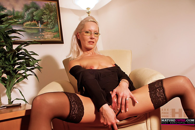 Shaved blonde in fishnets toying videos