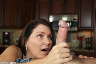 curious brunette mom rubbing
