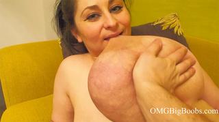dude pinching huge breasts