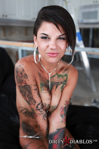 heavily inked brunette shows