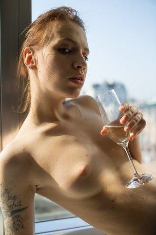 tatooed girl strips lingerie
