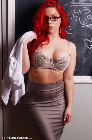 redhead teacher displays smoking