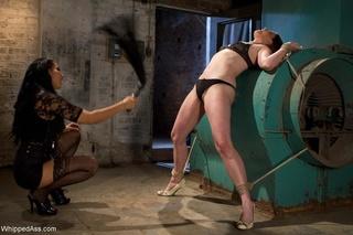 dark haired mistress punishing