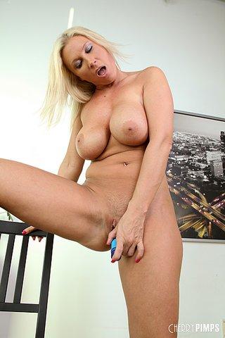 foxy blonde cougar seduces