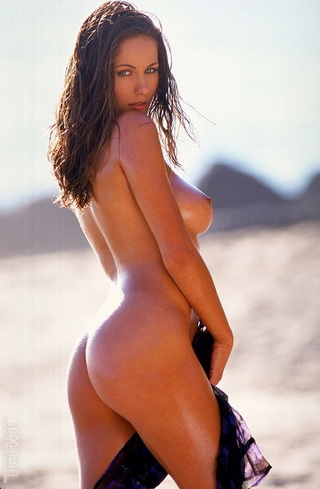 beautiful tanned brunette flaunts