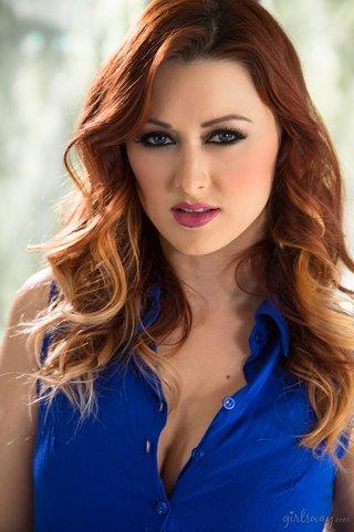 dazzling blonde redhead wearing