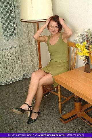 skinny grandma sits brown