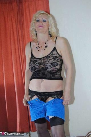 blonde gilf strips poses