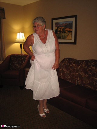 nasty granny enjoys posing