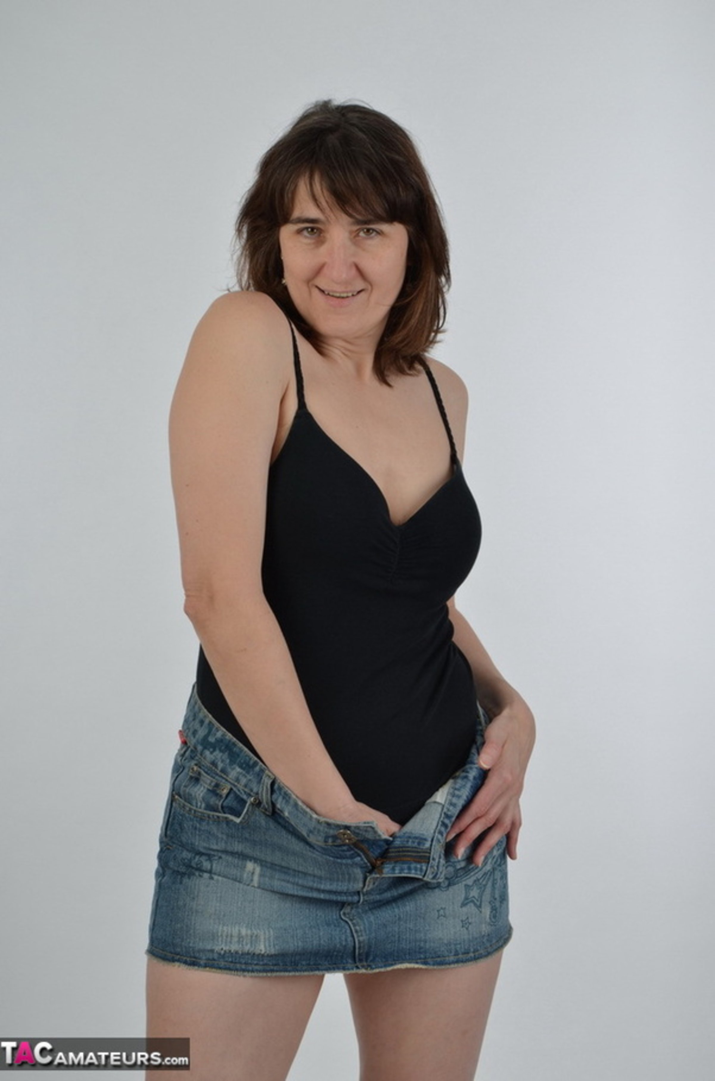 Brunette Milf In Black And Denim Skirt Gets Naked To Show