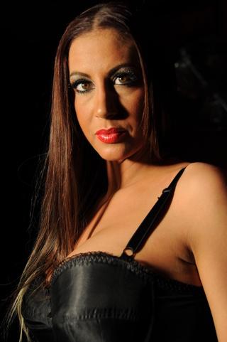 red lipstick brunette corset