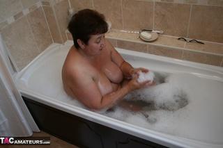 lusty granny displays chubby