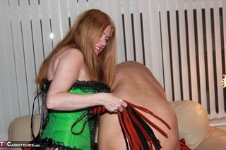 redhead wife green corset