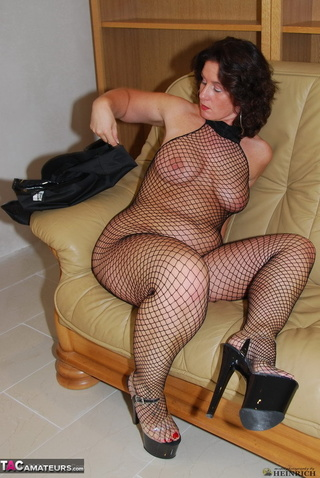 busty brunette fishnet bodystockings