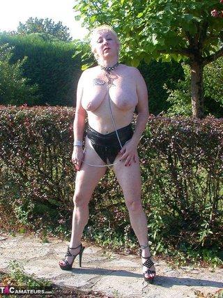 busty blonde leash posing