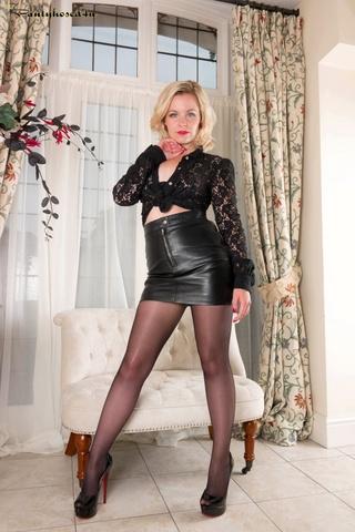 short-haired blonde leather miniskirt