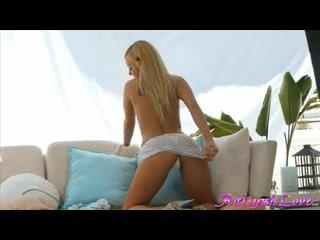 bikini-wearing blonde pink heels