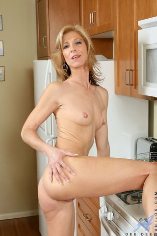 tall blonde milf poses