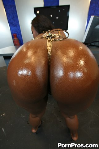 busty ebony oiled and