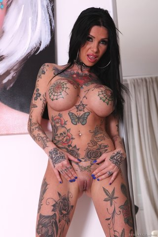Skanky milf with piercings and tattoos