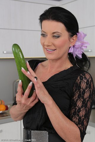 Mature masturbates with a cucumber