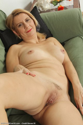slender mature undressing